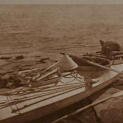 Kaiak with seal hunting equipment, Nunivak (1928)